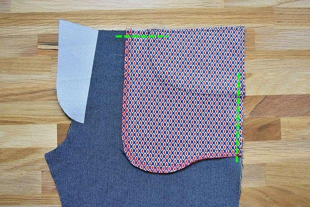 Lose Kanten des Taschenbeutels an Vorderhose heften