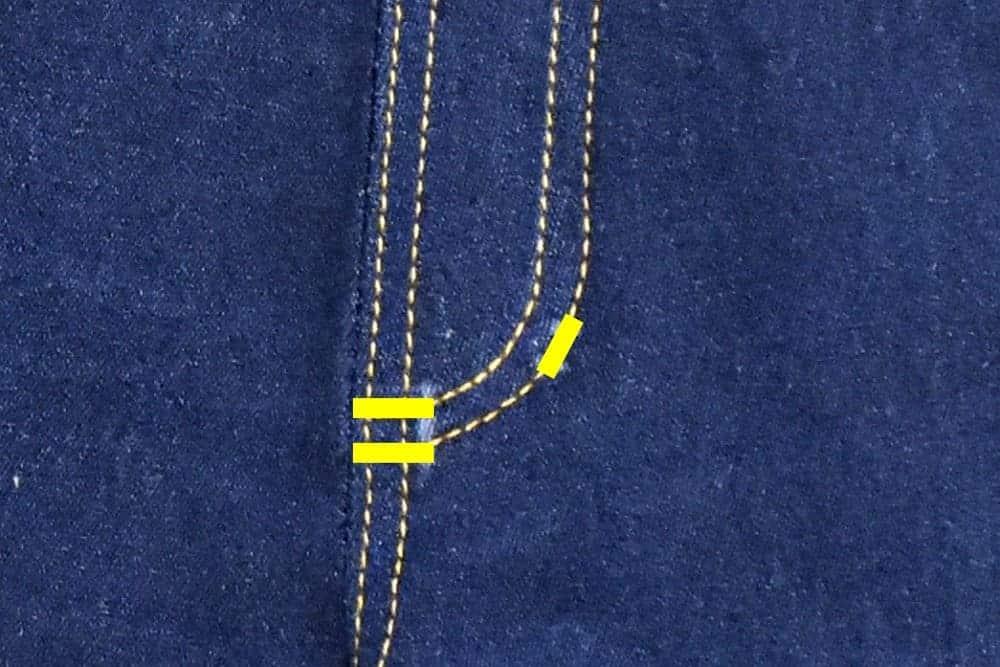 Markierung für die Raupennähte an der Jeans